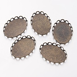Cuvettes de lunette ovales plates en laiton à bord en dentelle, suports à cabochon, sans nickel, bronze antique, environ 19 mm de large, bac: 18x25 mm; 26 mm de long, épaisseur de 2mm(X-KK-E185-AB-NF)